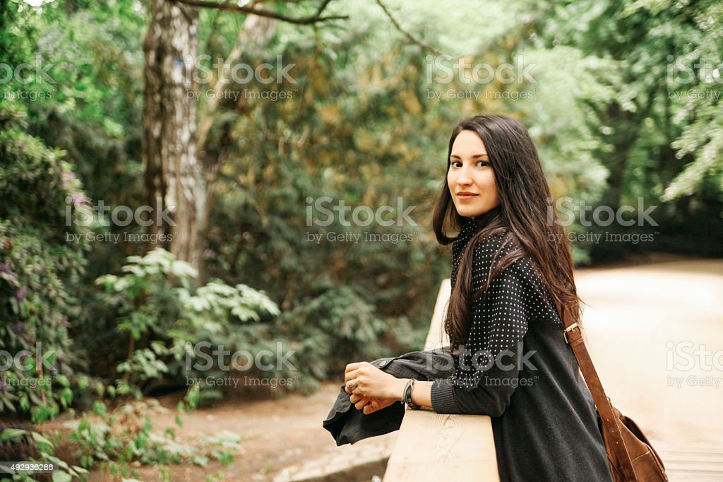 Vintage toned portrait of a young woman in Tiergarten park stock photo