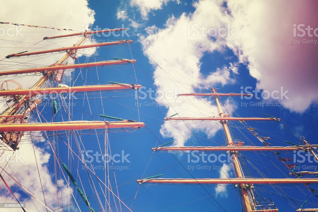 Vintage toned sailing vessel masts, looking up perspective stock photo