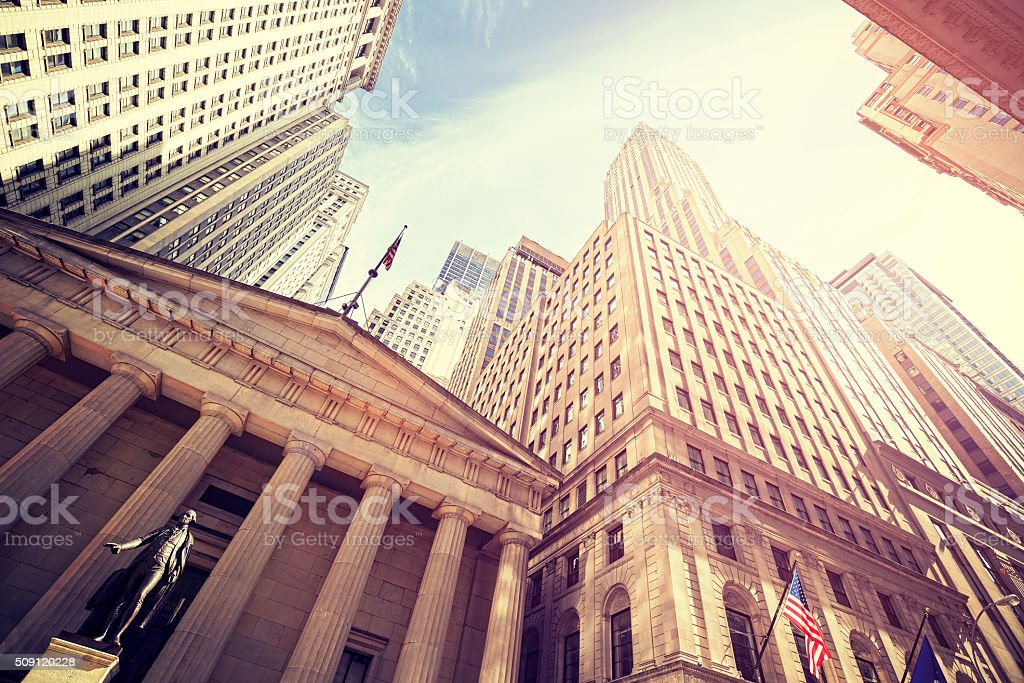 Vintage toned Wall Street at sunset, NYC. stock photo