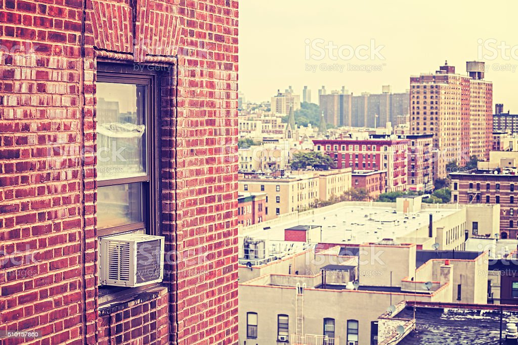 Vintage toned window with air conditioner, Harlem, USA stock photo