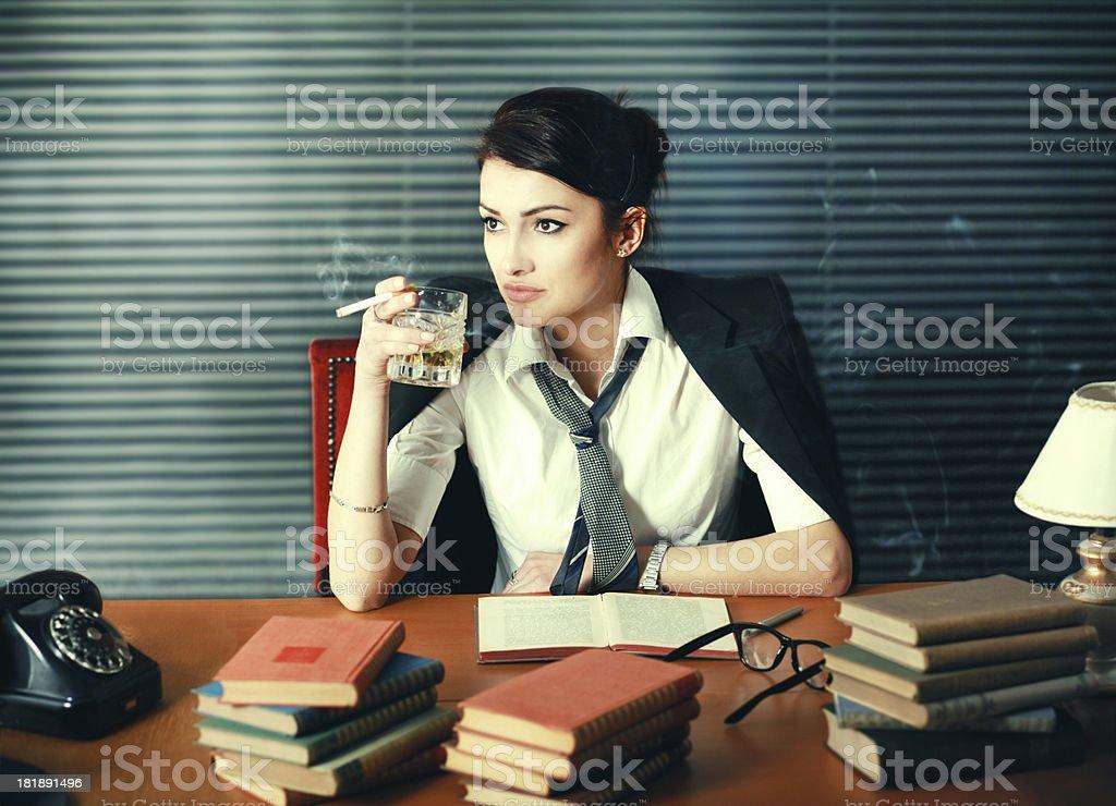 Vintage toned woman writer drinking and smoking, seeking inspiration royalty-free stock photo