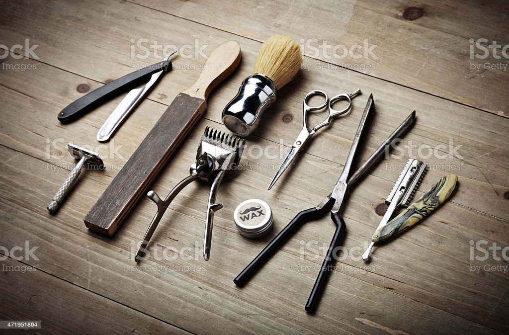 Vintage tools of barber shop on wood desk stock photo