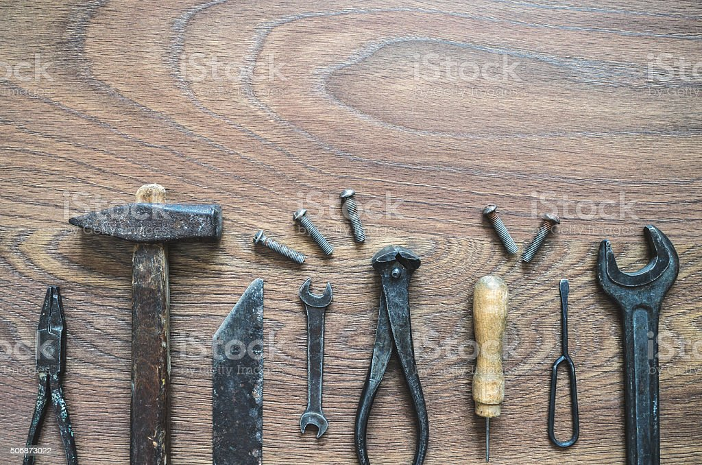 Vintage tools on wooden background stock photo