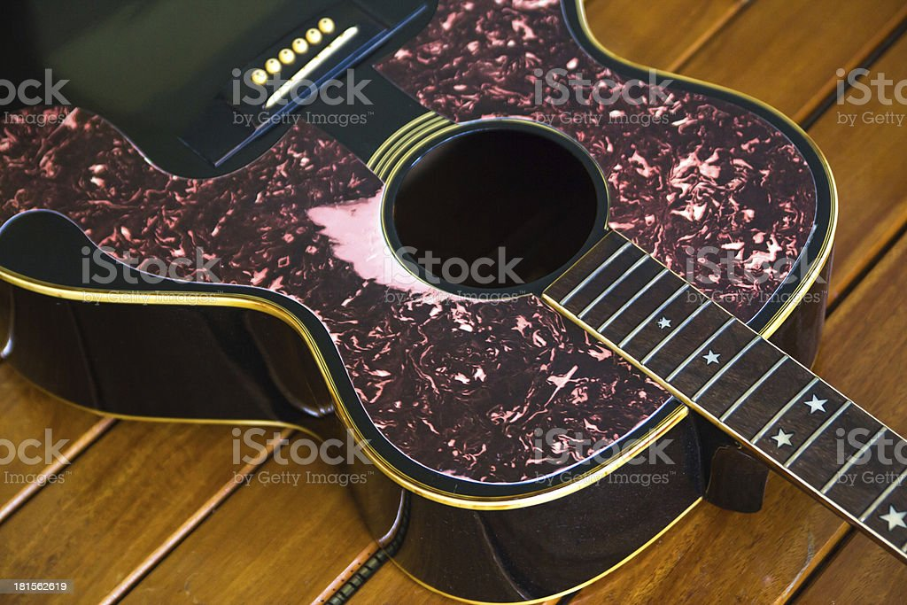 Vintage top guitar on old wood surface. royalty-free stock photo