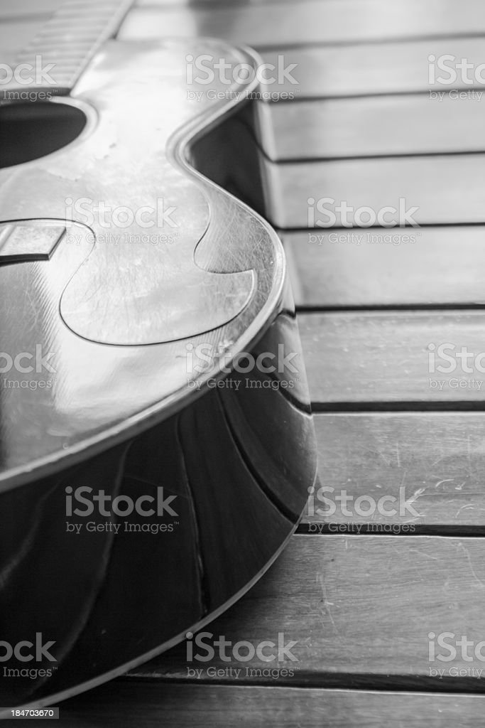 Vintage top guitar on old wood surface. stock photo