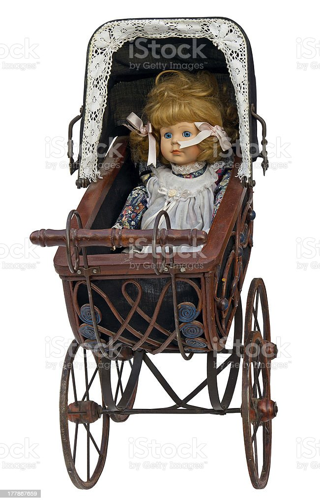 Vintage toy pram with doll royalty-free stock photo