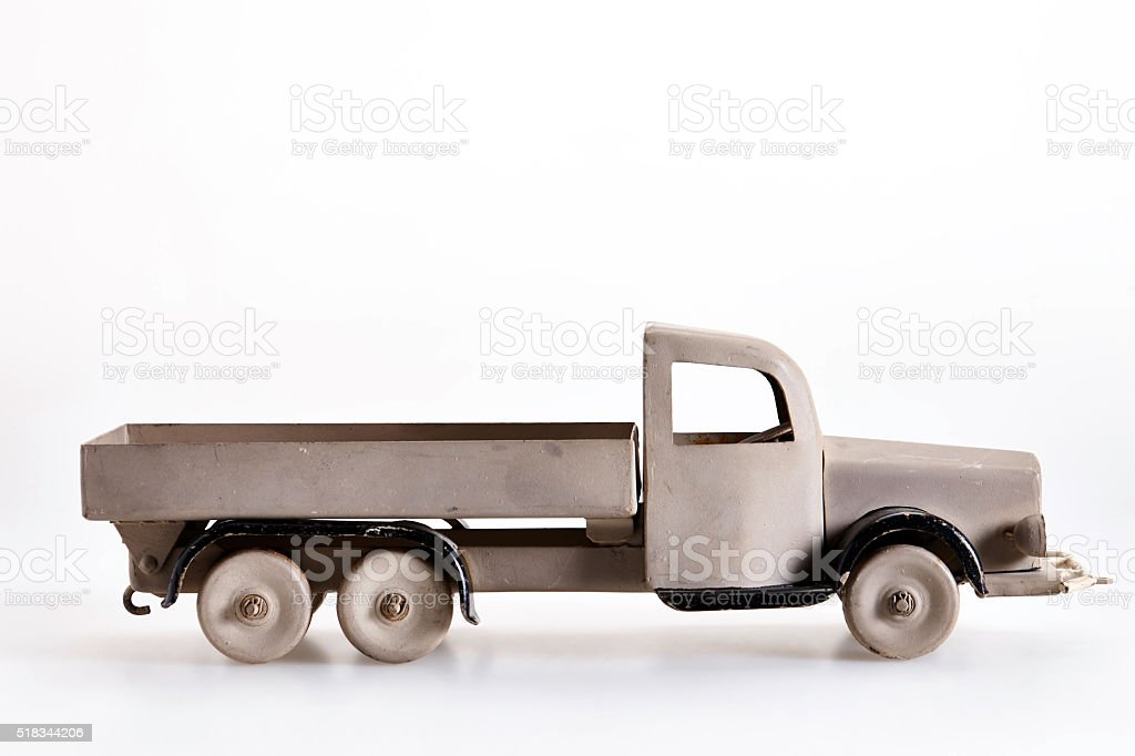 Vintage toy truck made of sheet metal on white background stock photo