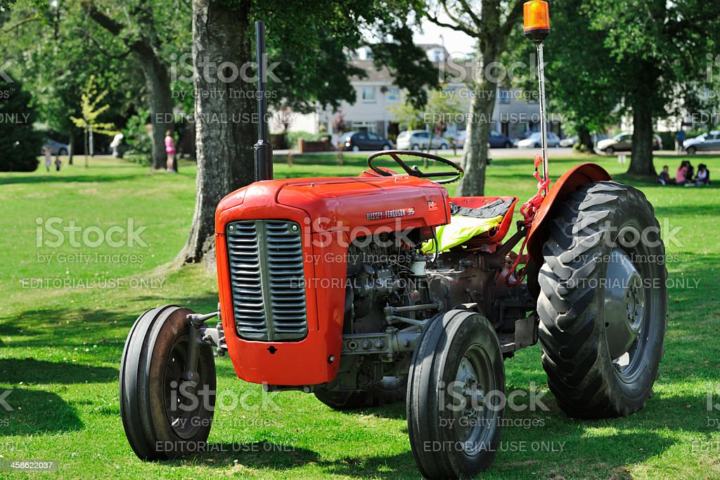 Vintage tractor being display outdoors in a park stock photo