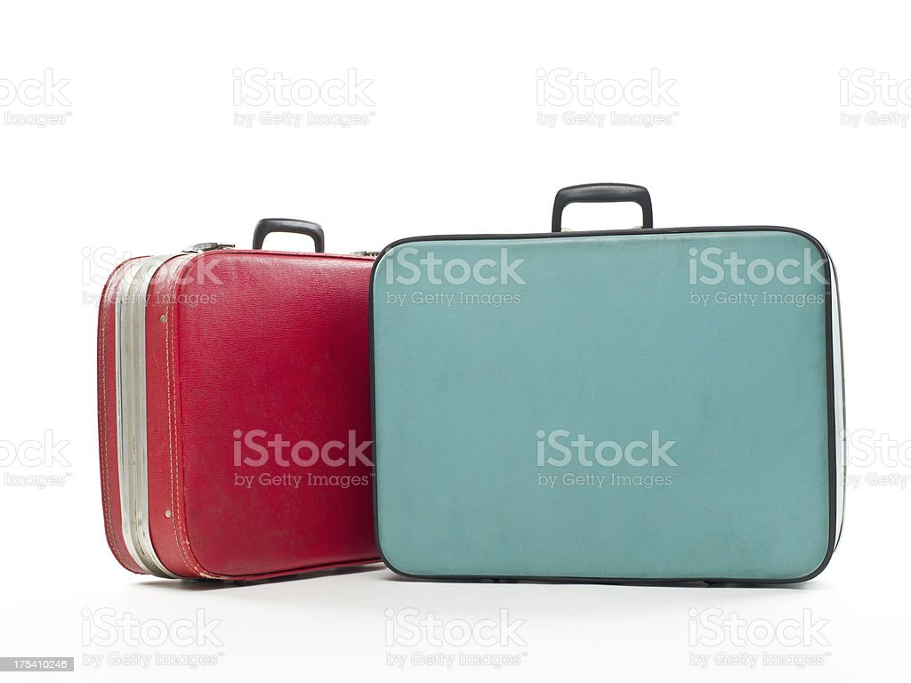 Vintage travel cases on white stock photo