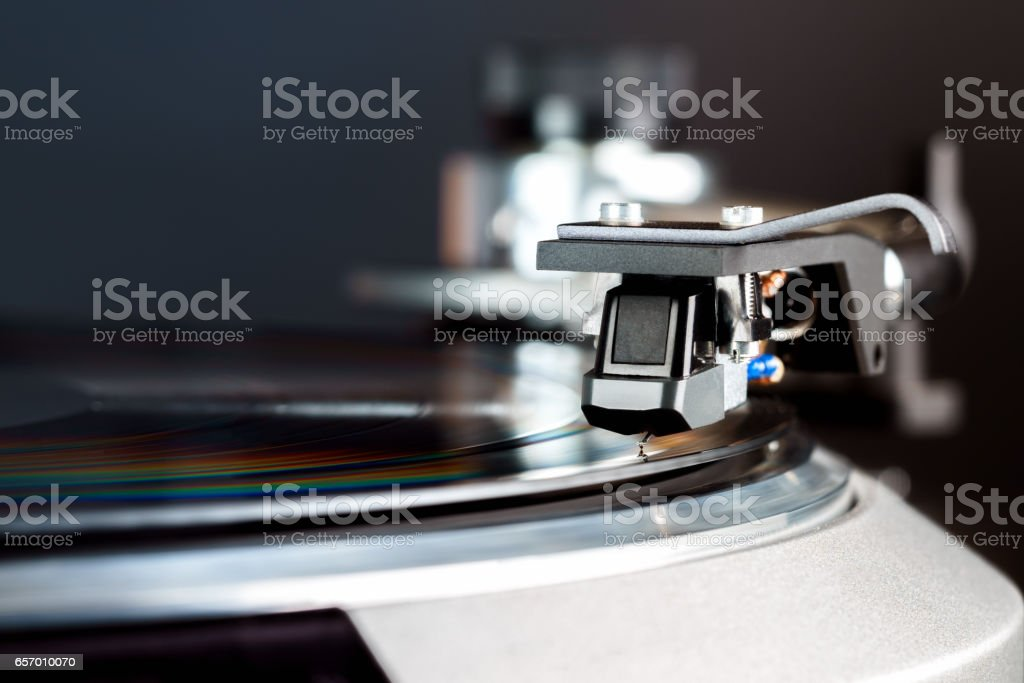 vintage turntable in action closeup stock photo