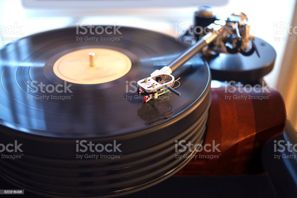 Vintage turntable playing vinyl record stock photo