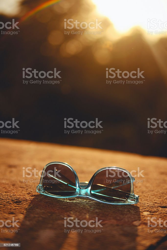 Vintage turquoise hipster sunglasses against the sunlight stock photo
