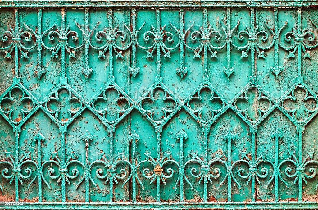 Vintage turquoise wrought iron fence stock photo
