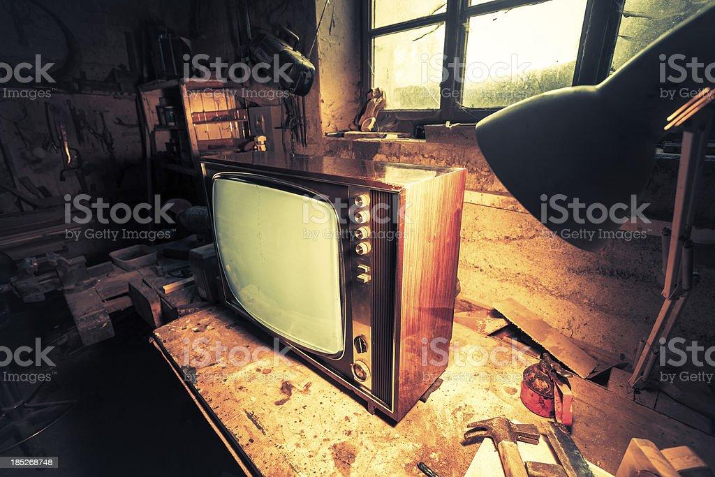 Vintage TV in Old Workshop royalty-free stock photo