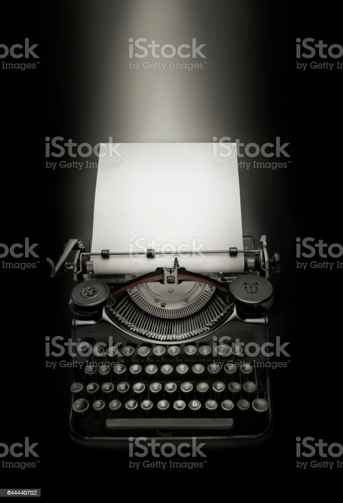 Vintage typewriter against black background stock photo