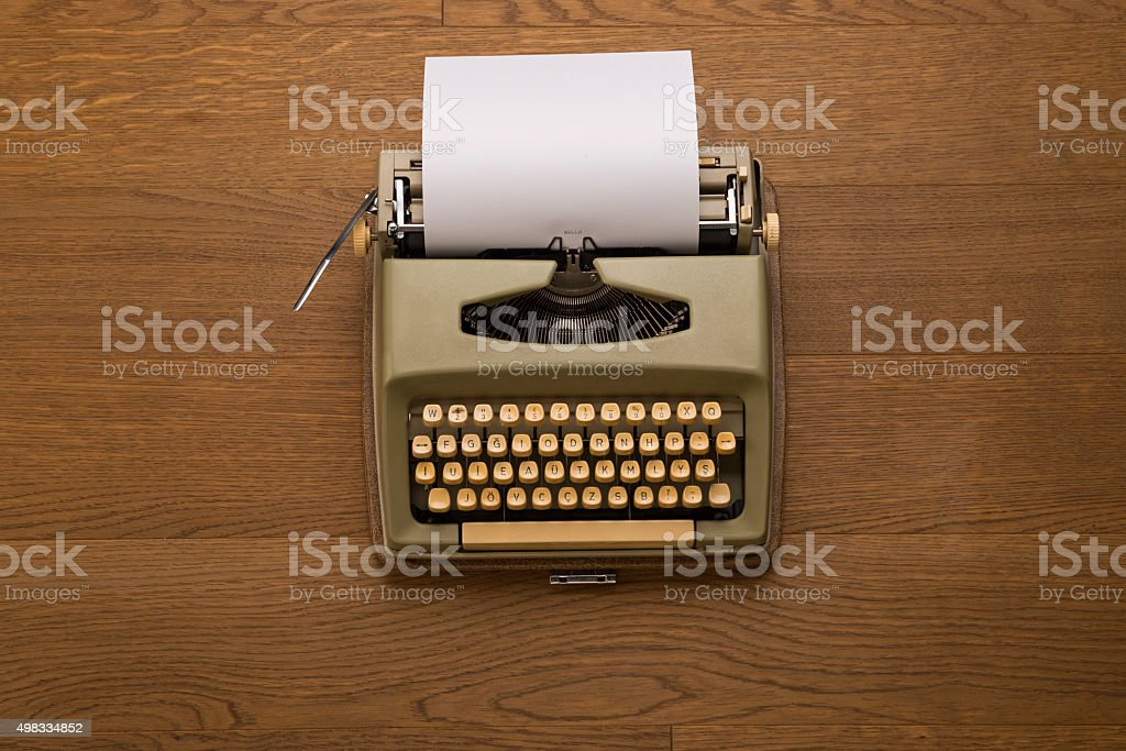 Vintage typewriter, book, papers and other objects stock photo