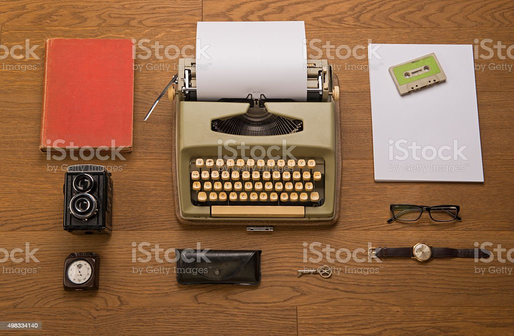Vintage typewriter, camera, altimeter, and other objects stock photo