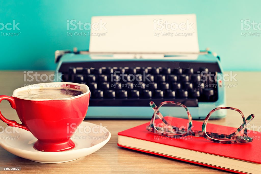 Vintage typewriter, coffee cup and eyeglasses stock photo