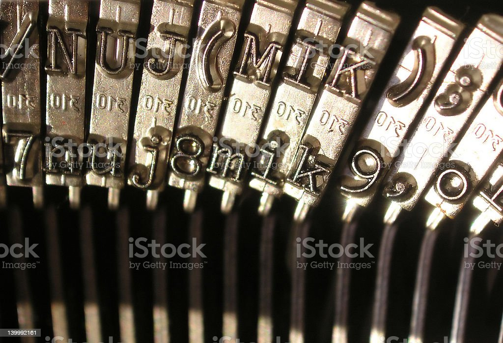 vintage typewriter macro with numbers and letters stock photo