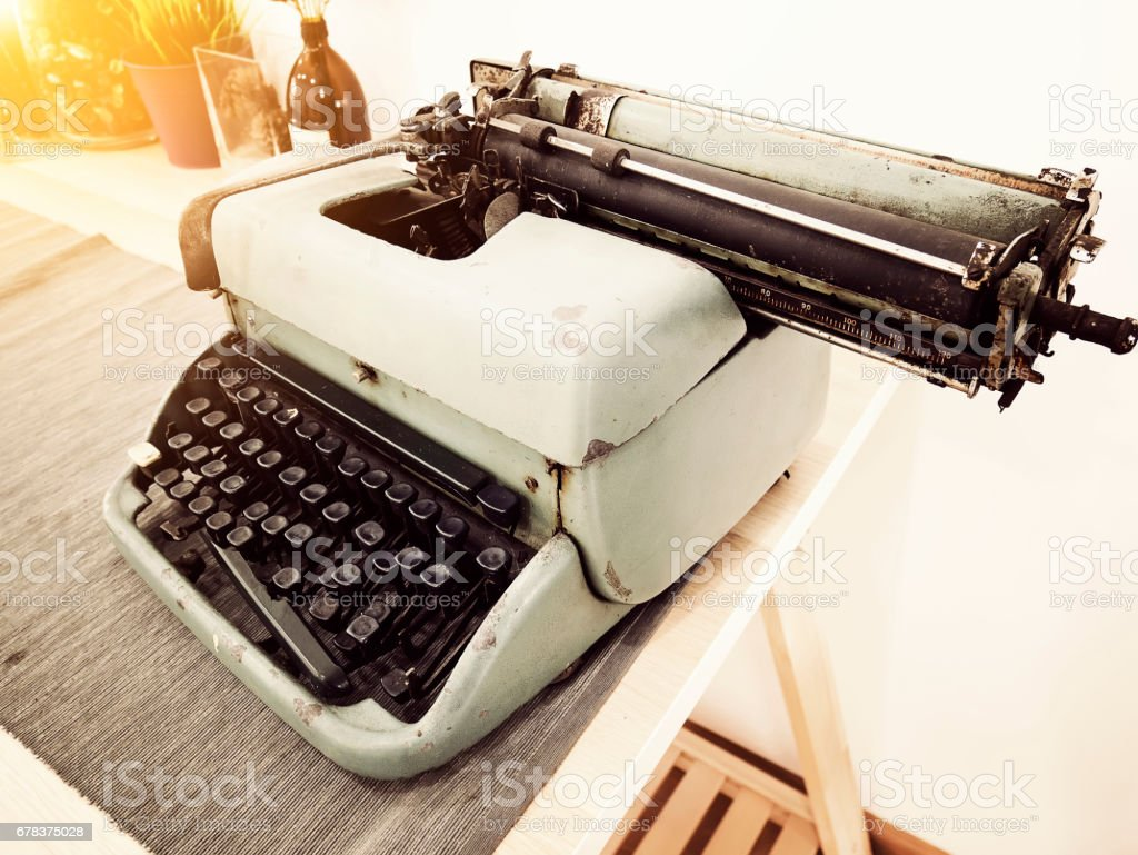 Vintage typewriter on the table stock photo