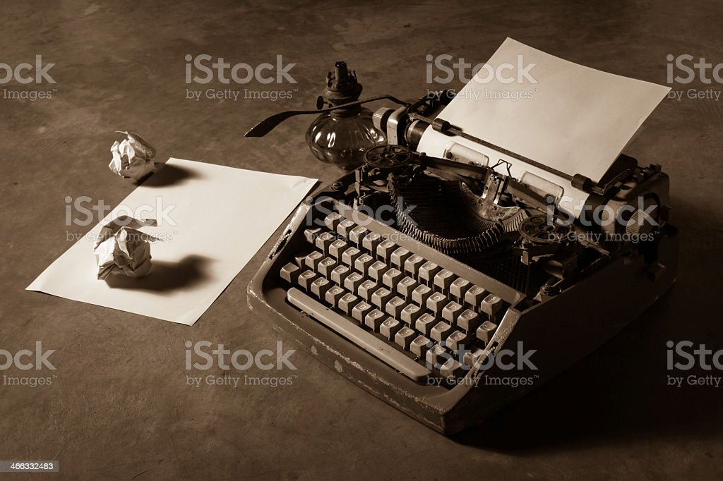 Vintage typewriter with blank white and crumpled paper stock photo