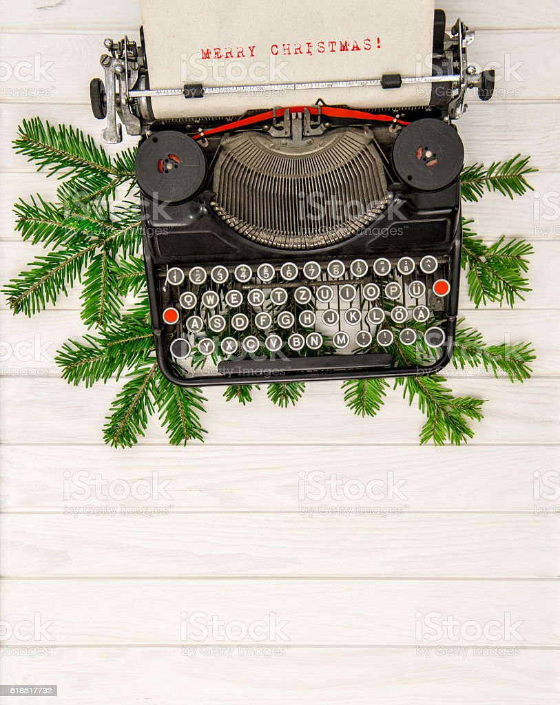 Vintage typewriter with christmas decoration Merry Christmas stock photo
