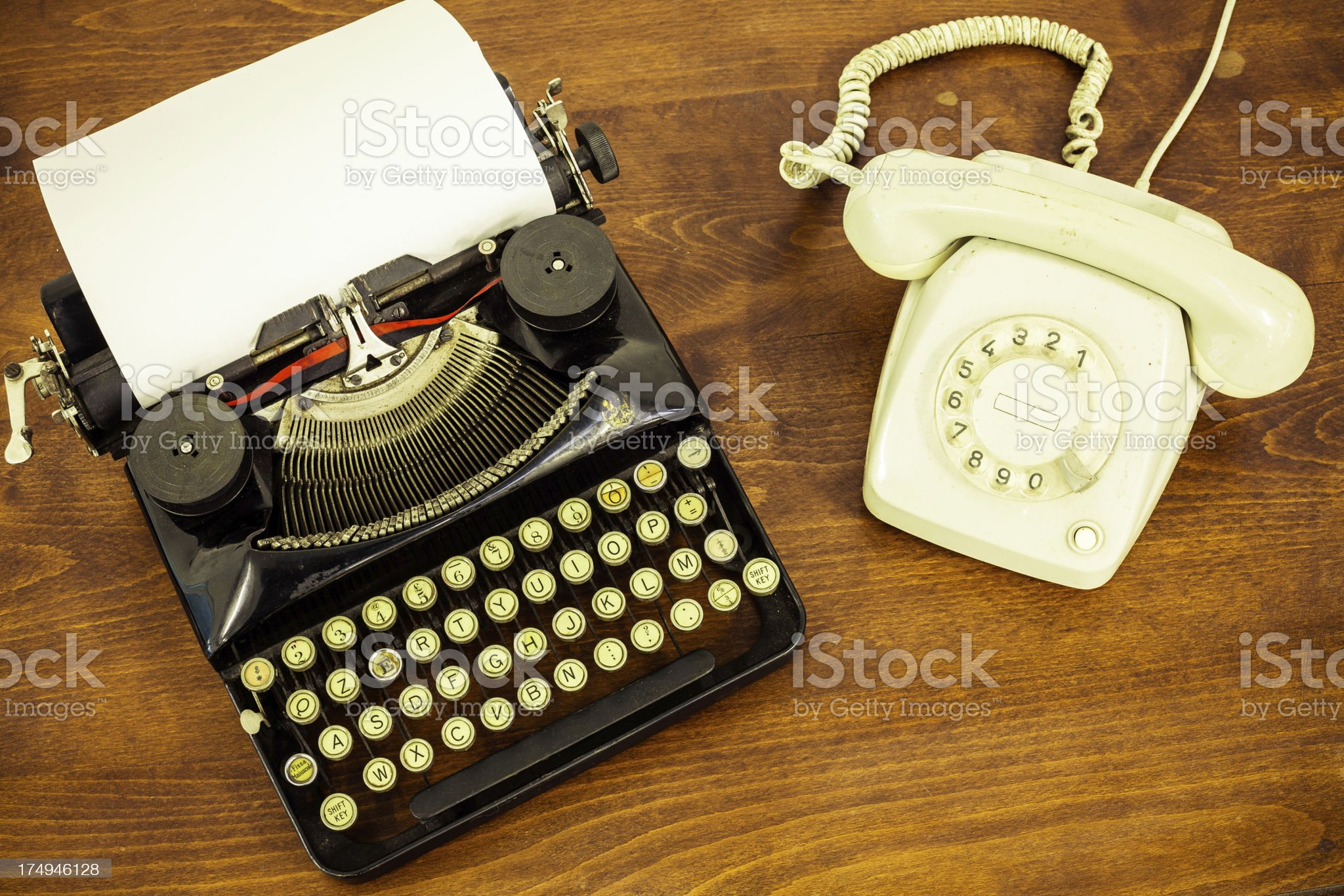 Vintage Typewriter with Old Telephone on Wooden Table royalty-free stock photo