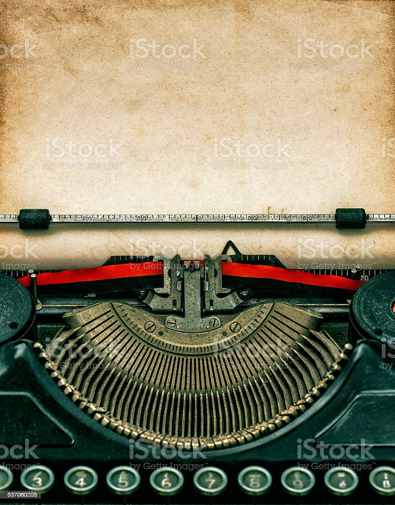 Vintage typewriter with textured grungy paper stock photo