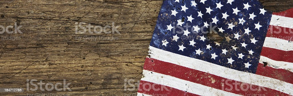 Vintage US flag on wooden board stock photo