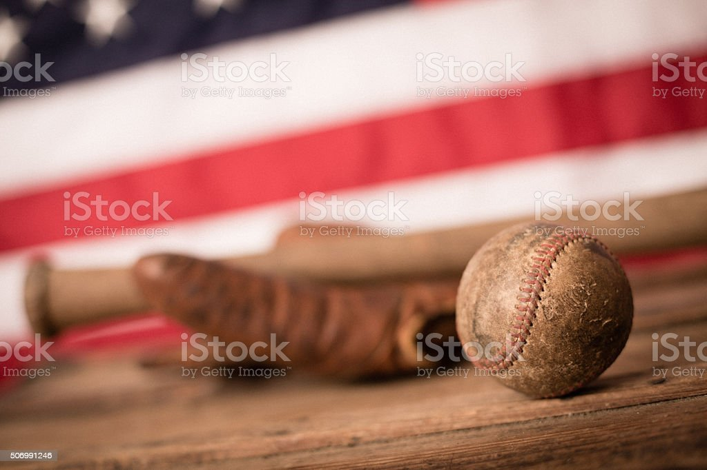 Vintage Used Baseball, Glove and Bat with American Flag stock photo