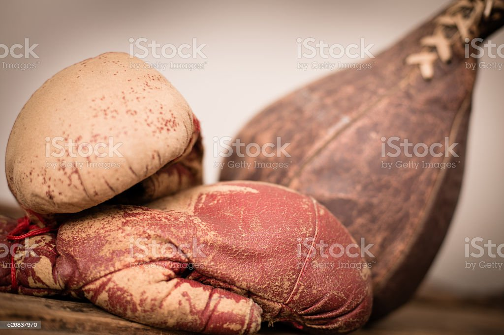 Vintage, Used Boxing Gloves and Punching Bag Closeup Photo stock photo