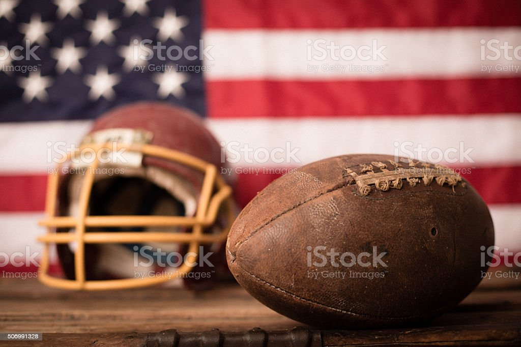 Vintage Used Sports Football and Helmet with American Flag stock photo