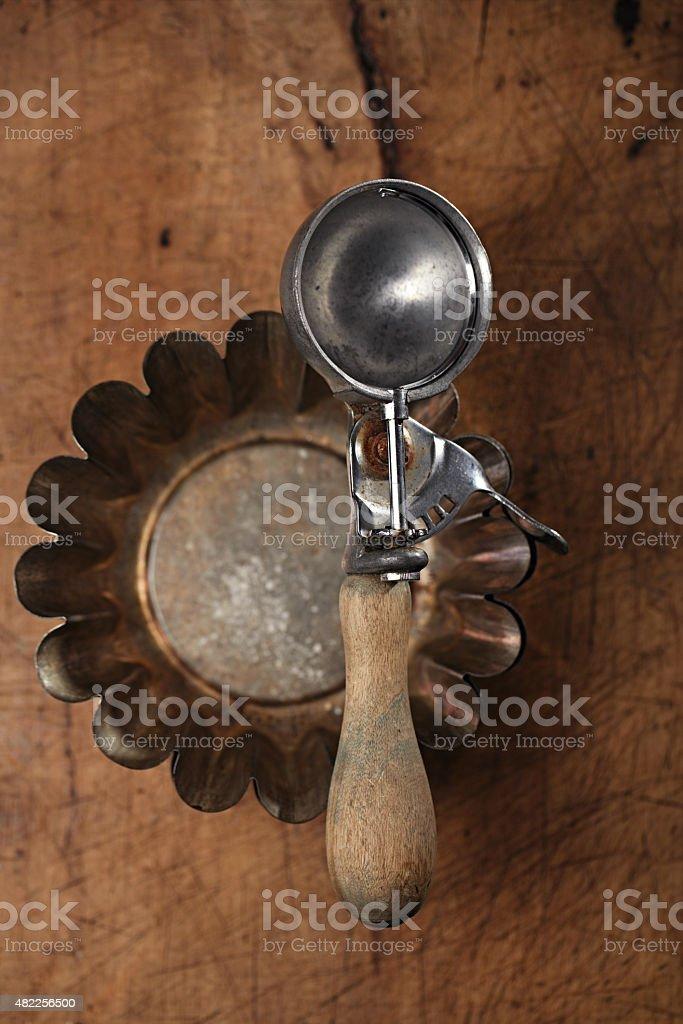 Vintage  utensils -  ice cream scoop on tin or  mold stock photo