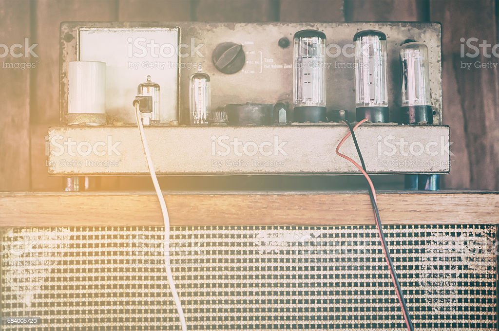 Vintage Vacum Valve tube amplifier in vintage filter with flair stock photo
