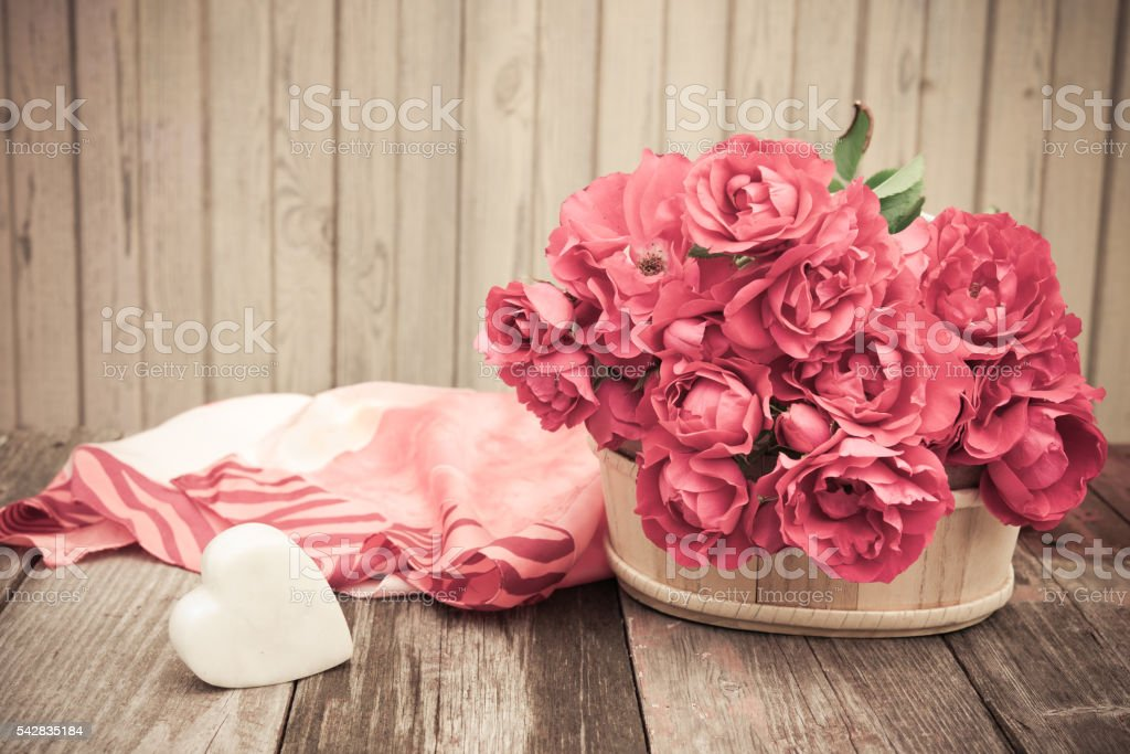 Vintage Valentine Floral background.  Bouquet of red roses with Heart stock photo