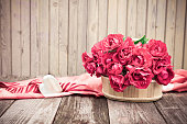 Vintage Valentine Floral background.  Bouquet of red roses with Heart
