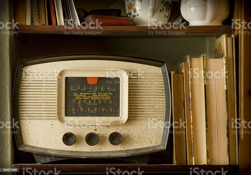 Vintage valve radio on shelving stock photo
