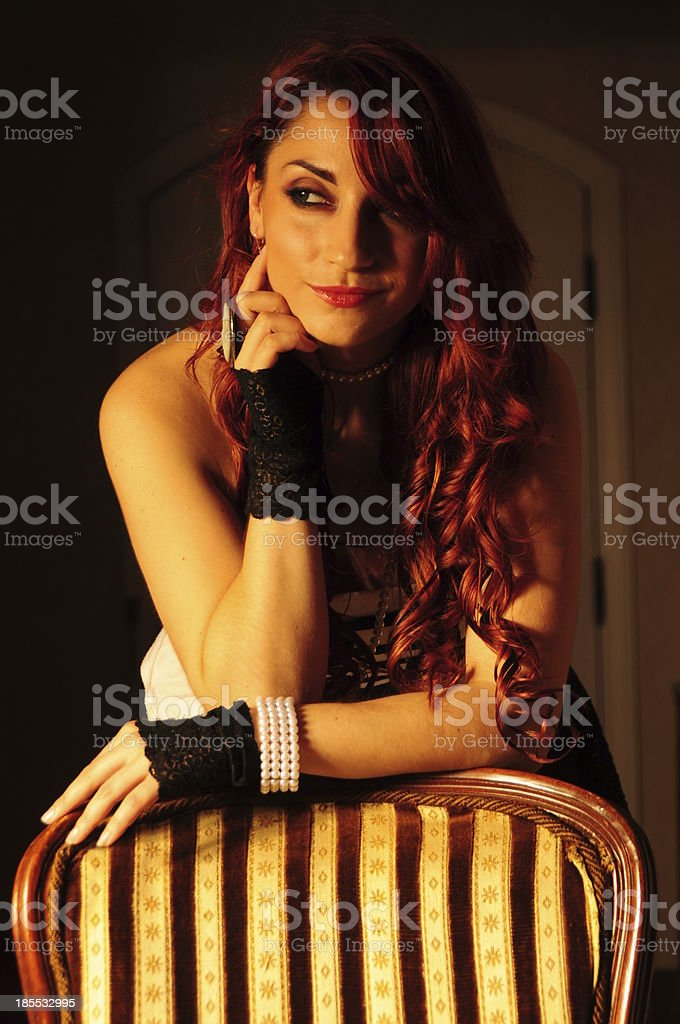 Vintage victorian glamour lady with curly red hair wearing gloves stock photo