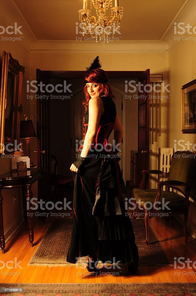 Vintage victorian glamour red hair lady in corset and feather royalty-free stock photo