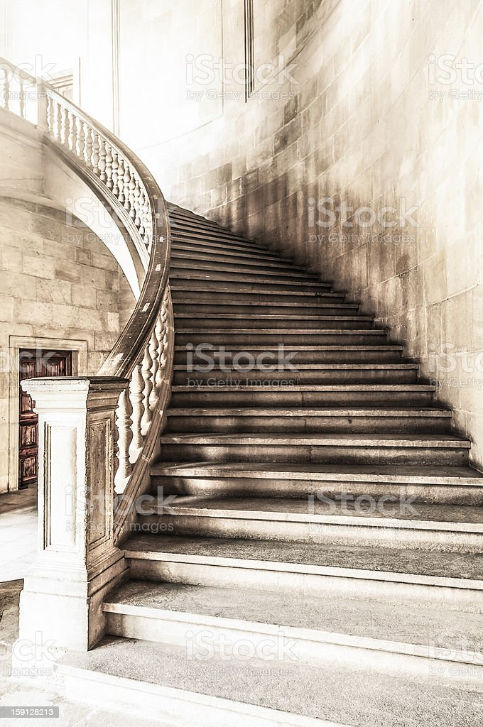 Vintage view of marble spiral staircase. stock photo