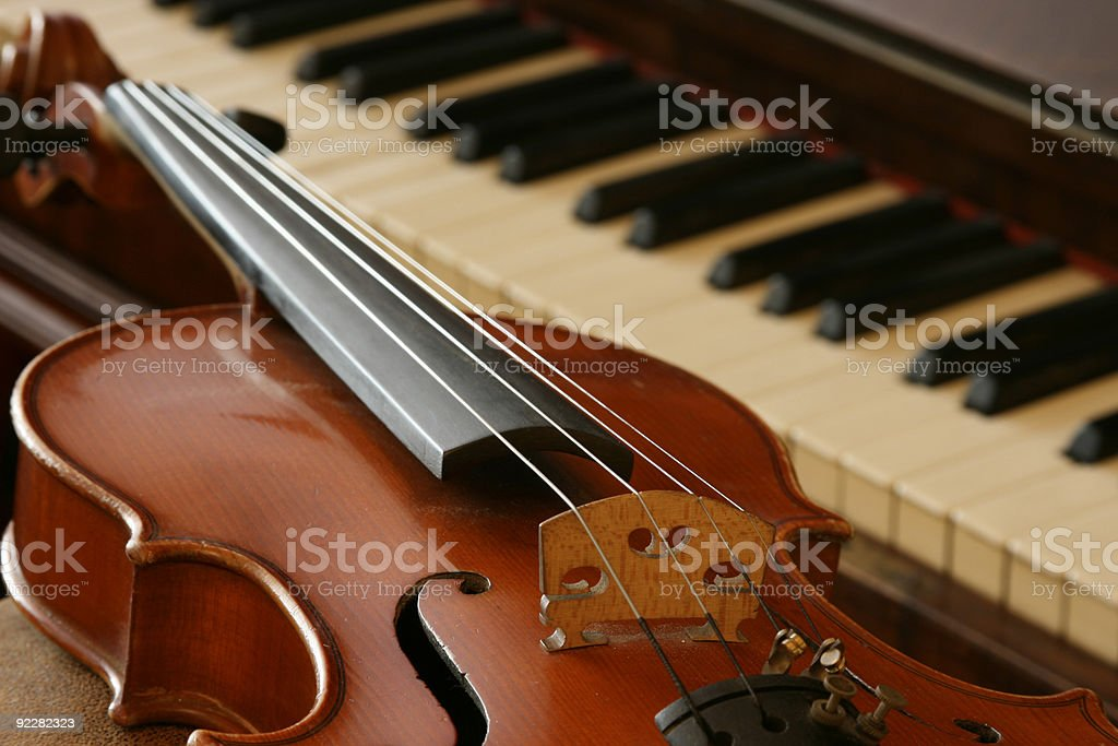 A vintage violin and grand piano stock photo