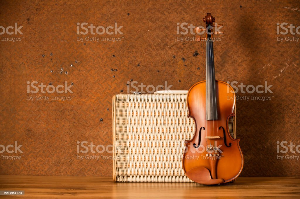 Vintage violin and luggage with old steel background with copy space stock photo