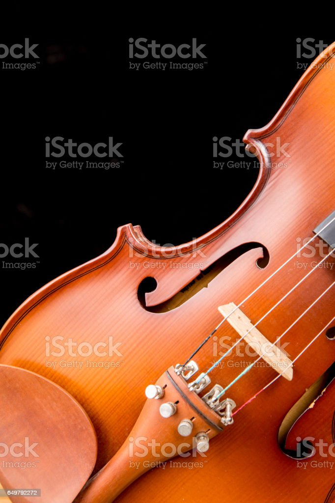 Vintage violin on black background stock photo