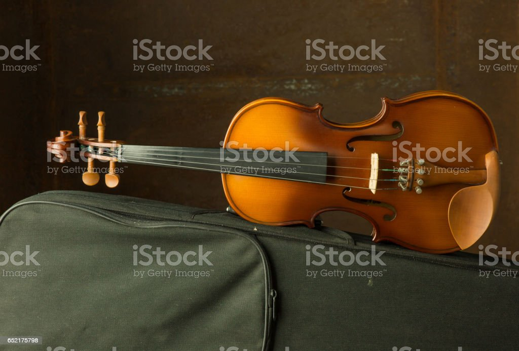 Vintage violin with old steel background stock photo