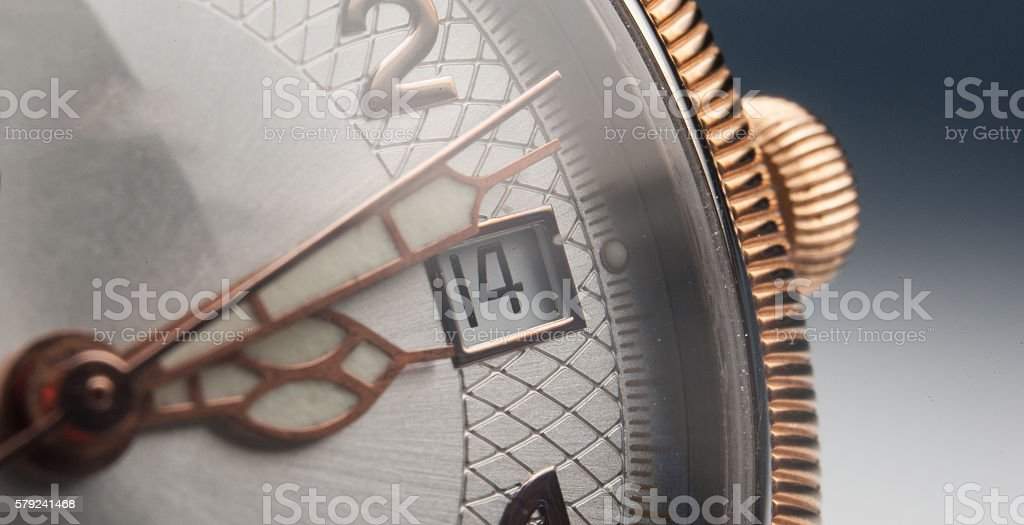 Vintage watch on a brown leather wallet. Classic Wristwatch. stock photo