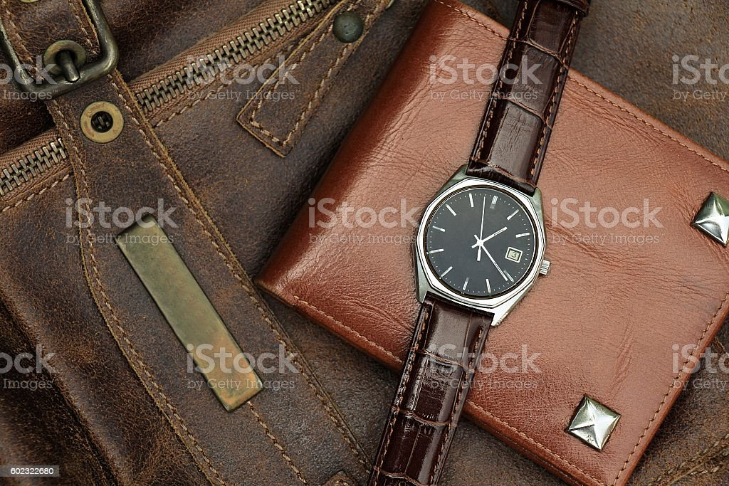Vintage watch on a brown leather wallet stock photo