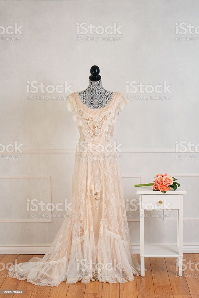 vintage wedding dress with rose bouquet stock photo