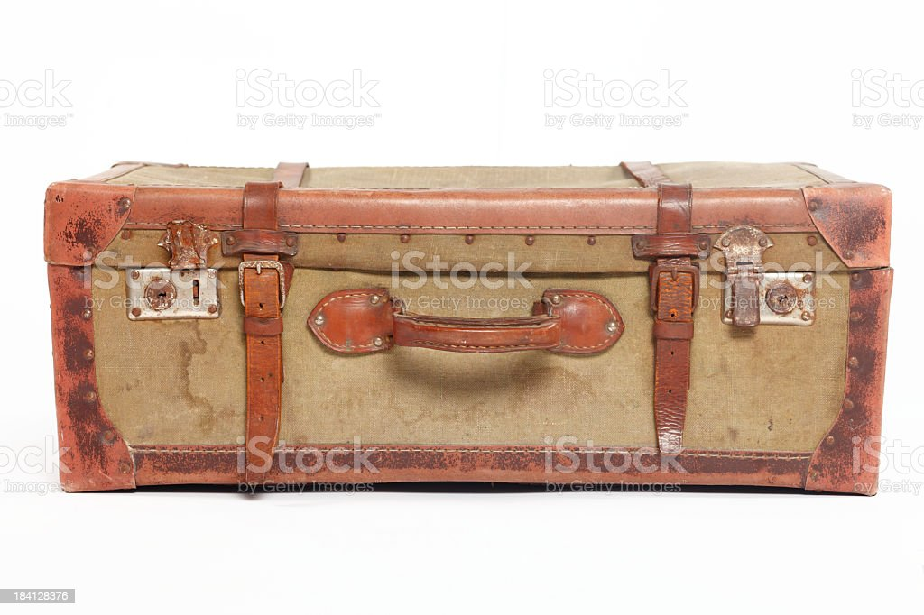 Vintage well-traveled suitcase with leather accents stock photo