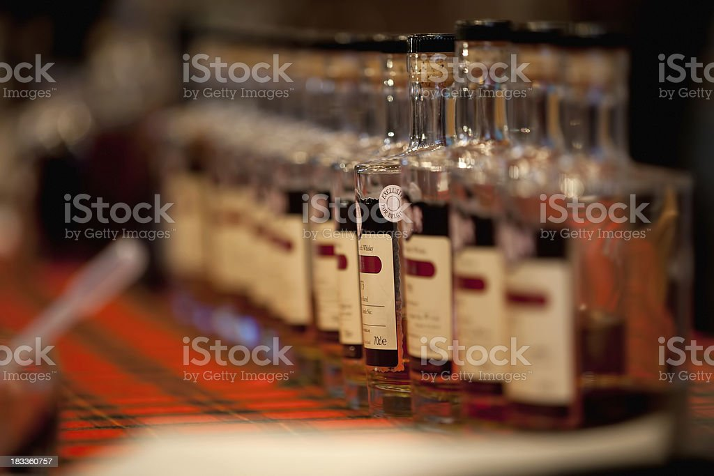 Vintage whiskey bottles in a row royalty-free stock photo