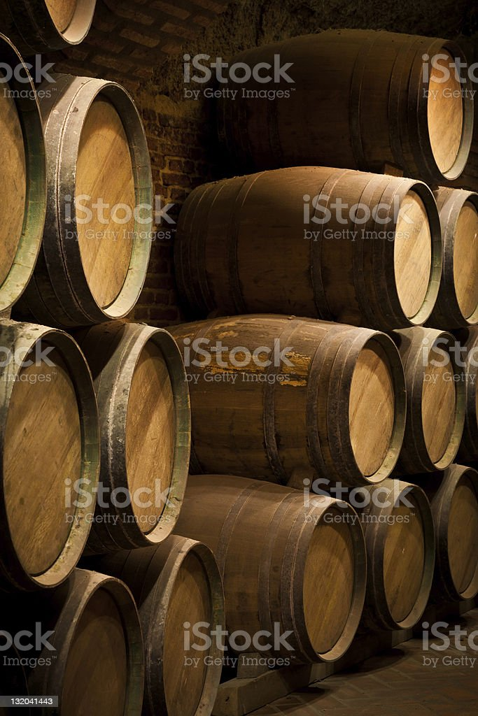 Vintage wine barrels in an aging cellar royalty-free stock photo